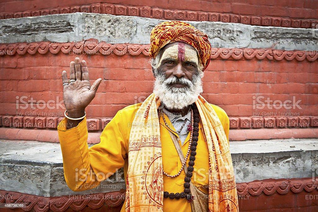 Shaiva sadhu seeks alms on the Pashupatinath Temple in Kathmandu. royalty-free stock photo