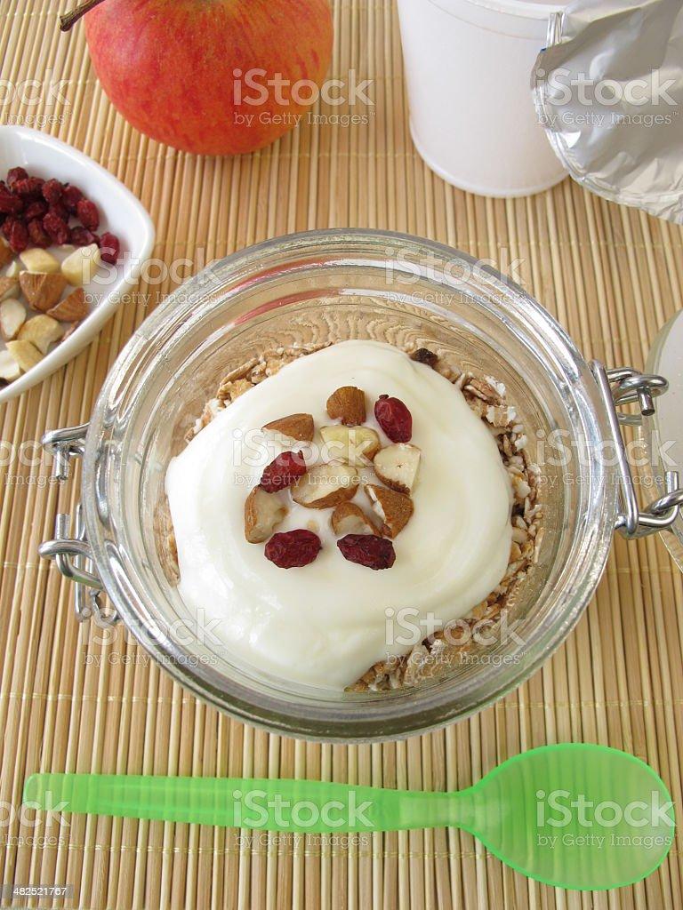 Shake muesli with yogurt in a jar stock photo