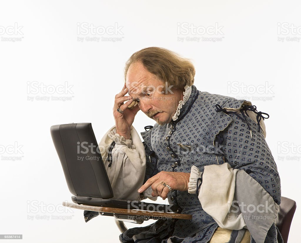 Shakespeare using laptop. stock photo
