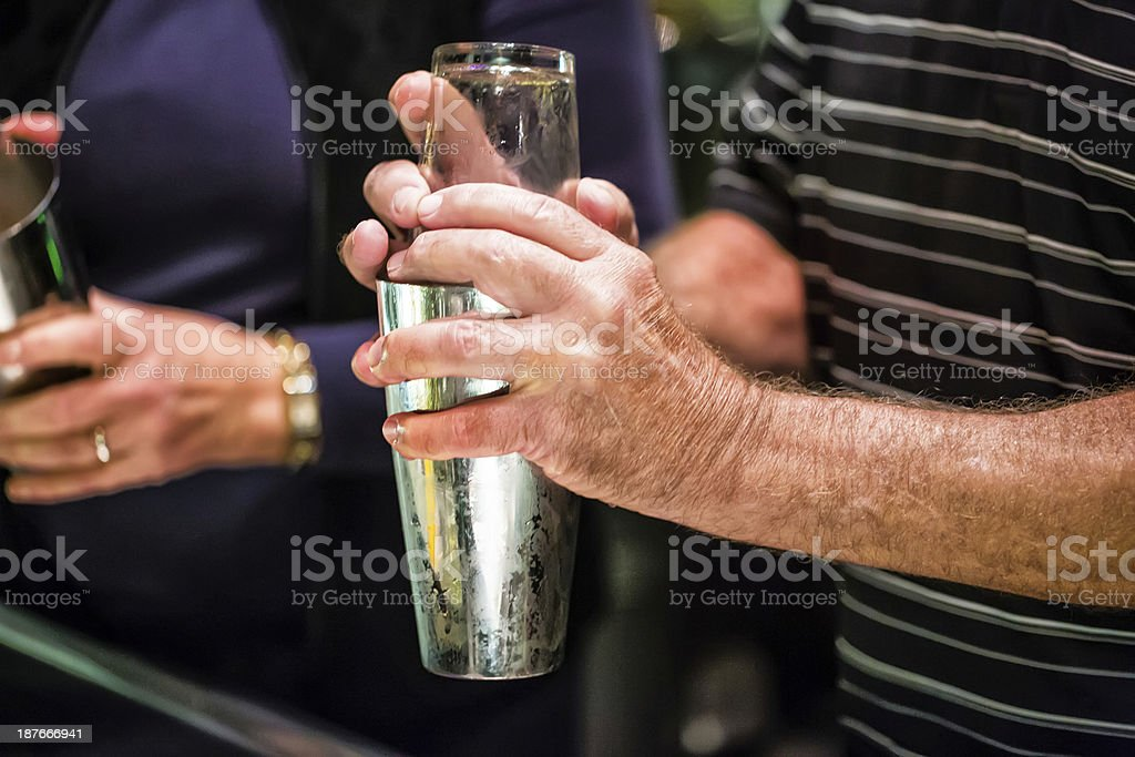 Shaking an alcoholic drink on New year's Eve royalty-free stock photo