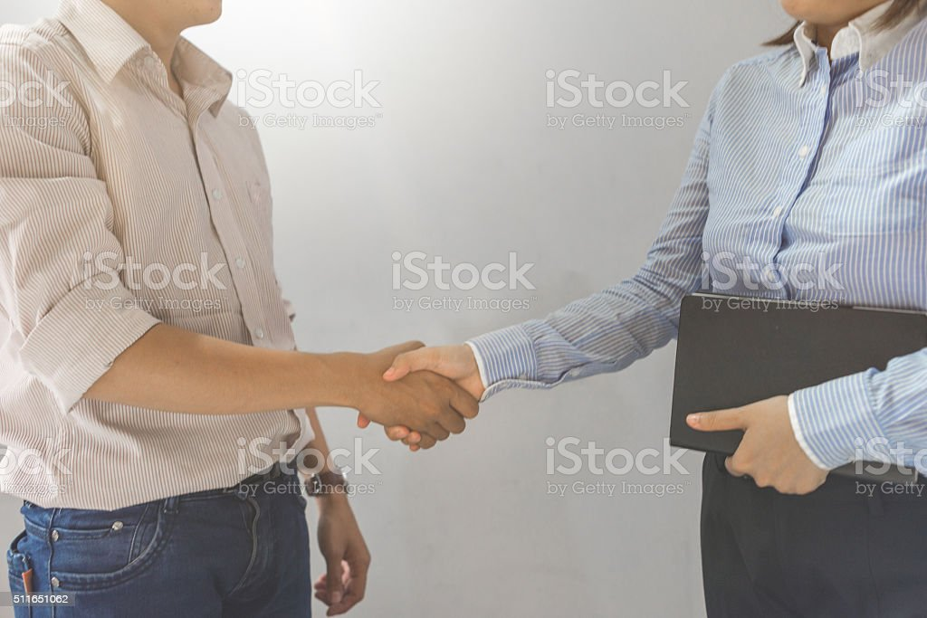Shaking hand between business partners after successfully signed contract stock photo