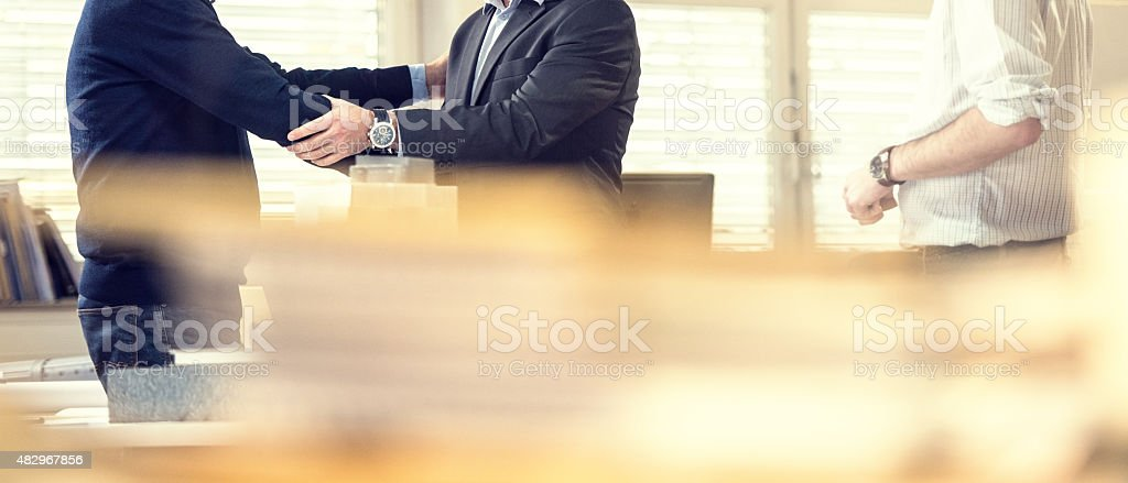 Shaking hand with client stock photo
