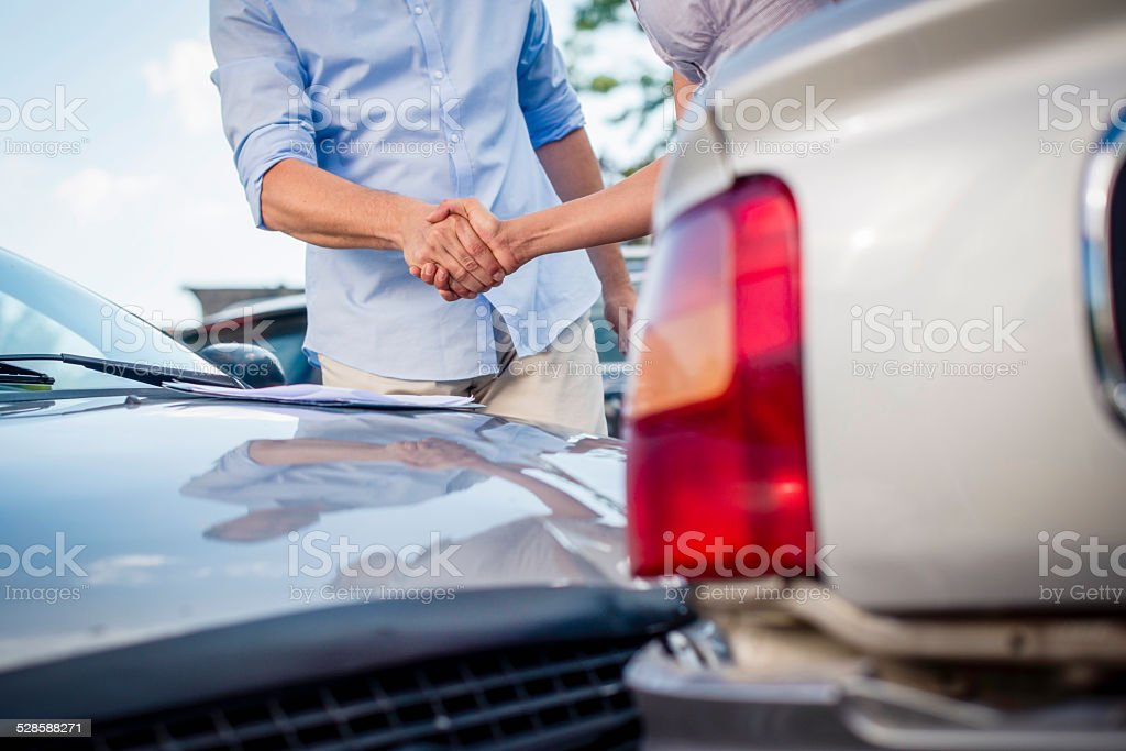 Shaking Hands after Car Accident stock photo