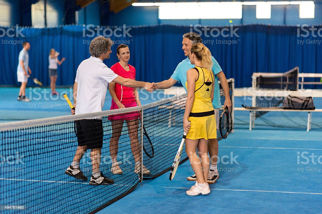 Shaking Hands After Playing Mixed Doubles stock photo