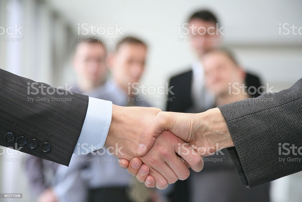 shaking hands and business team stock photo