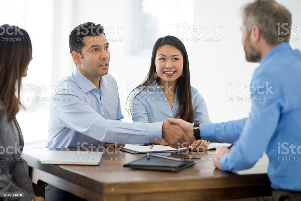 Shaking Hands Before an Interview stock photo