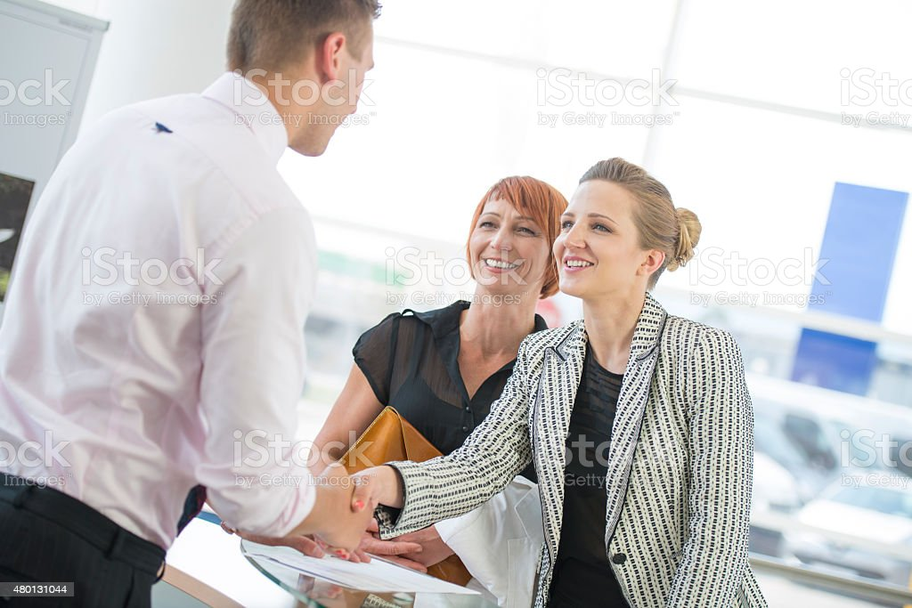 Shaking Hands in the Office stock photo