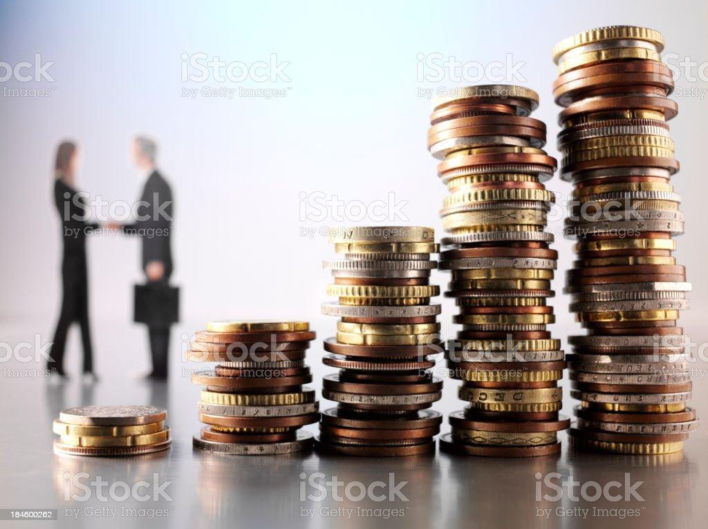 Shaking Hands over Money stock photo