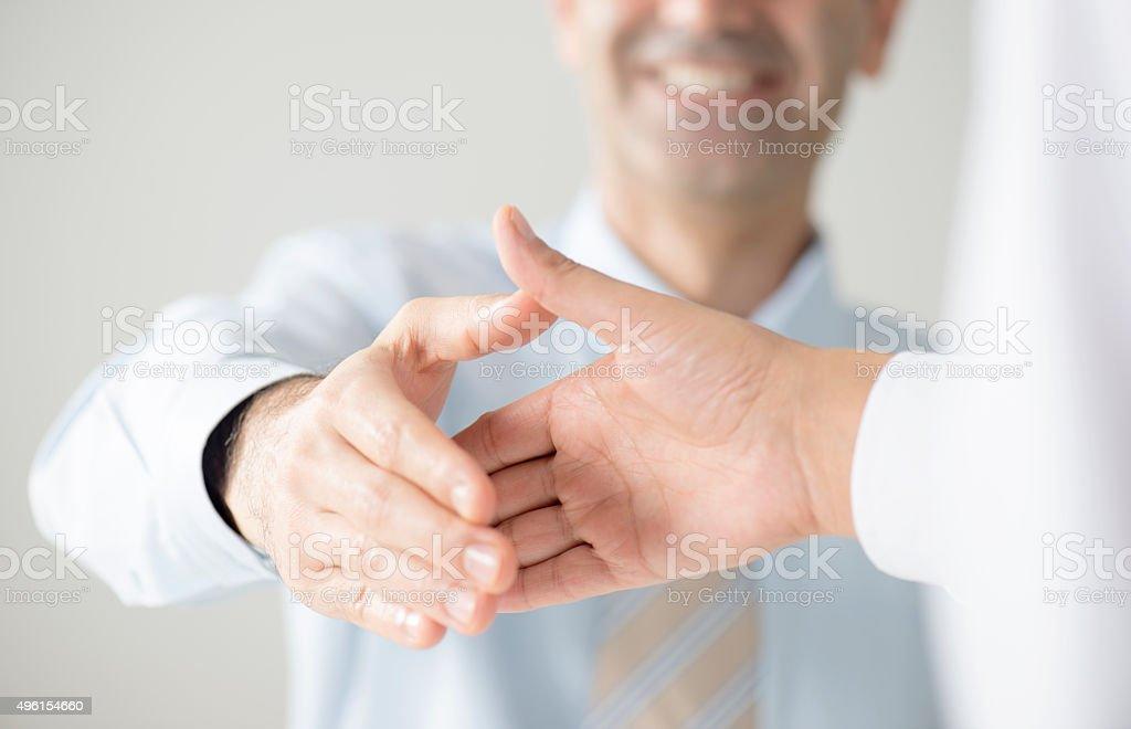 Shaking hands stock photo