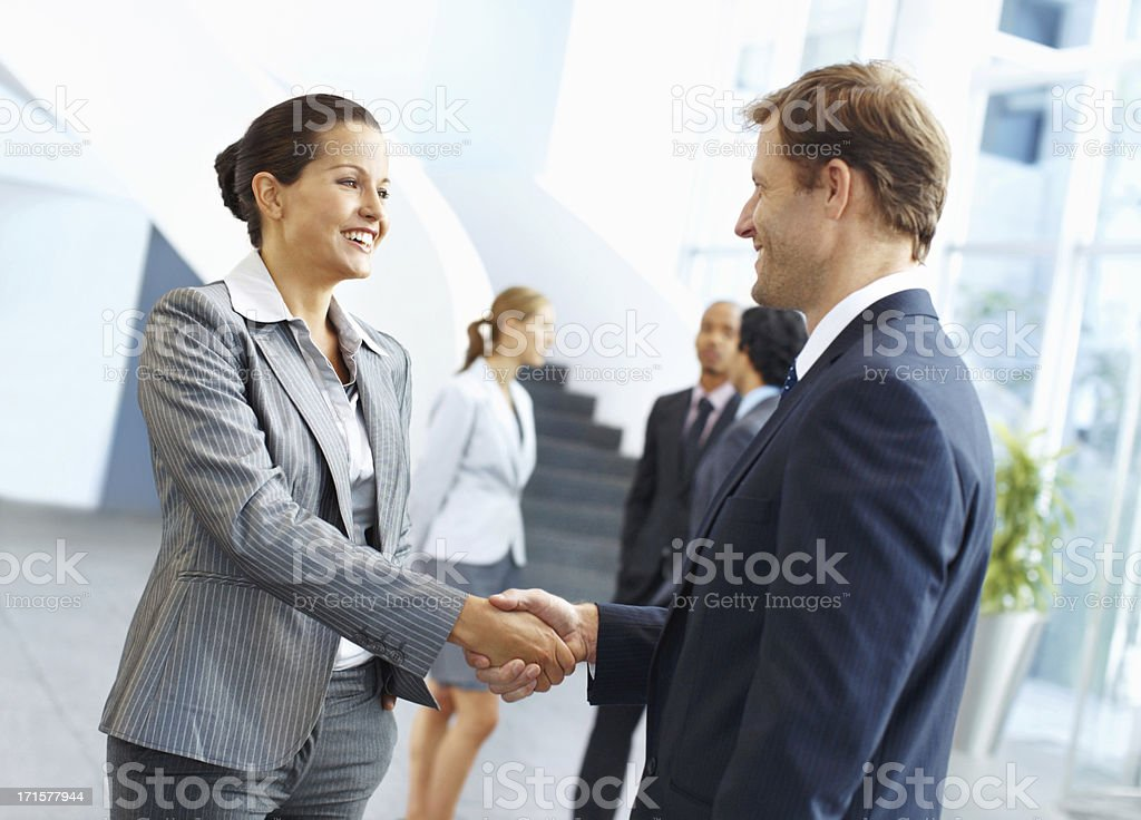 Shaking hands to their success royalty-free stock photo