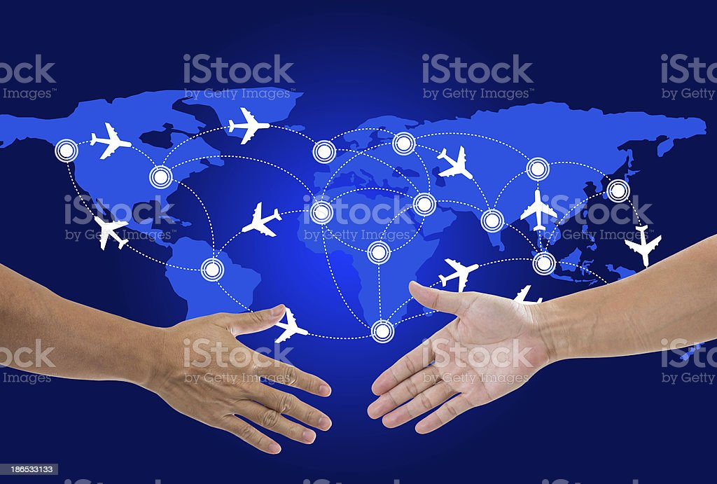 Shaking hands with world map  background stock photo