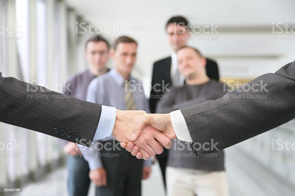 shaking hands with wrists and business team 2 stock photo