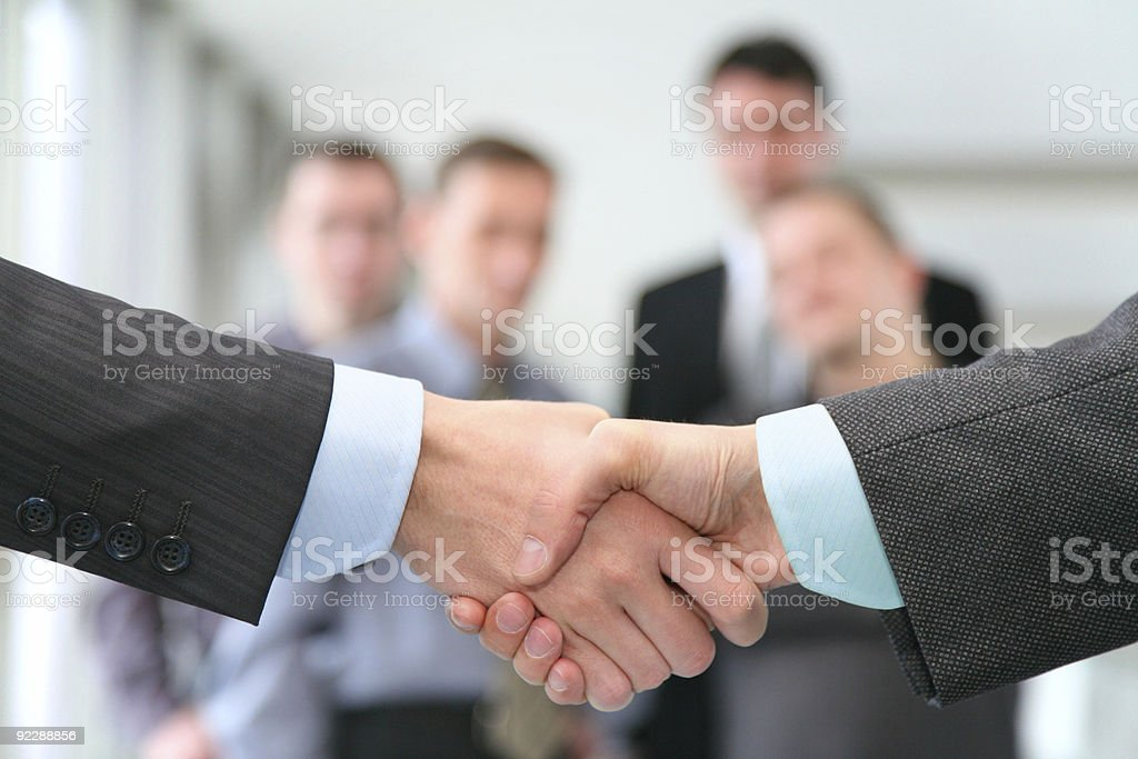 shaking hands with wrists and business team royalty-free stock photo