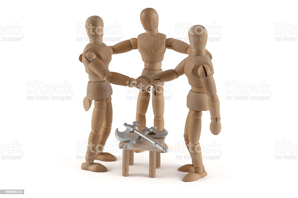 Shaking hands - wooden mannequin after Mediaton stock photo