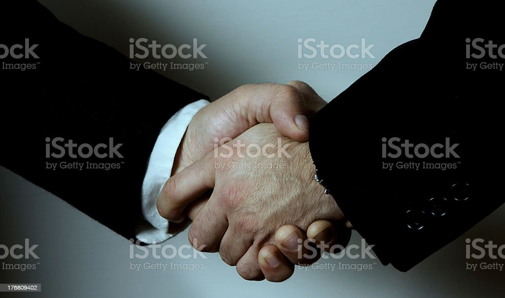 shaking on a deal royalty-free stock photo