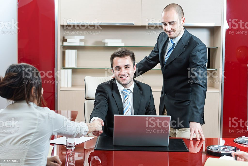 Shaking over the deal stock photo