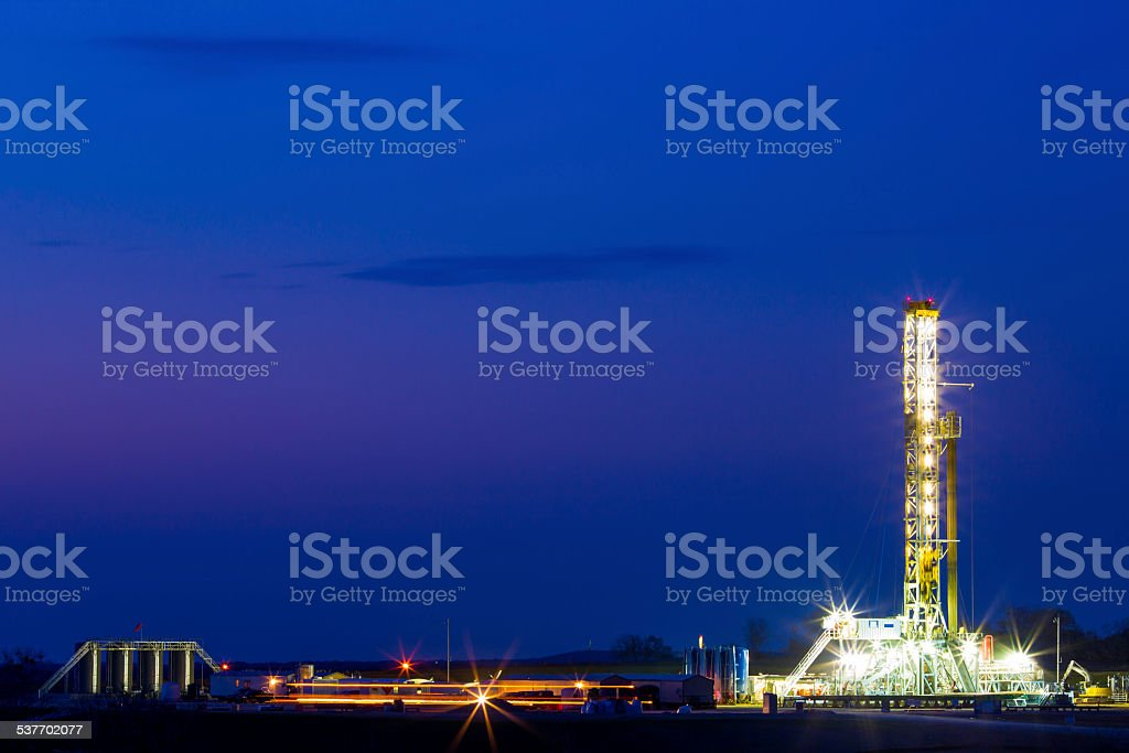Shale Oil Platform At Night W/ Light Trails. stock photo
