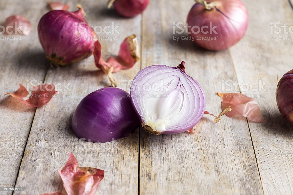Shallot onions in a group on wood,still life stock photo