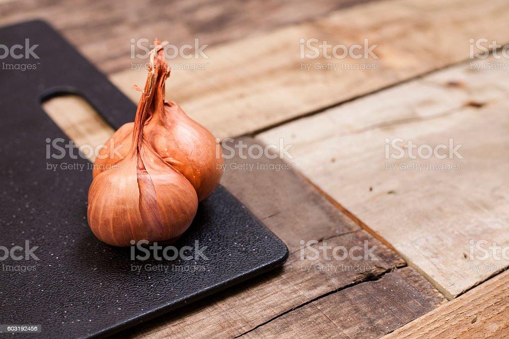 Shallots on cutting board. stock photo