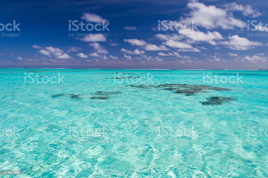 Shallow coral reef in turquoise transparent water, Cook Islands stock photo