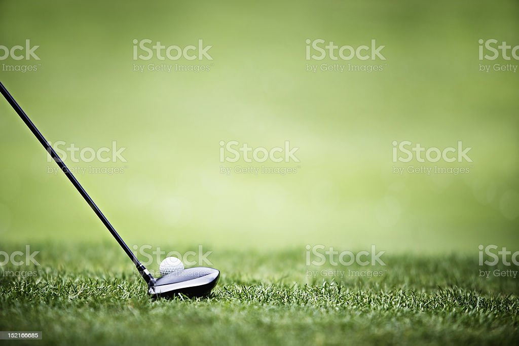 Shallow depth, golf ball and driver, driving range stock photo