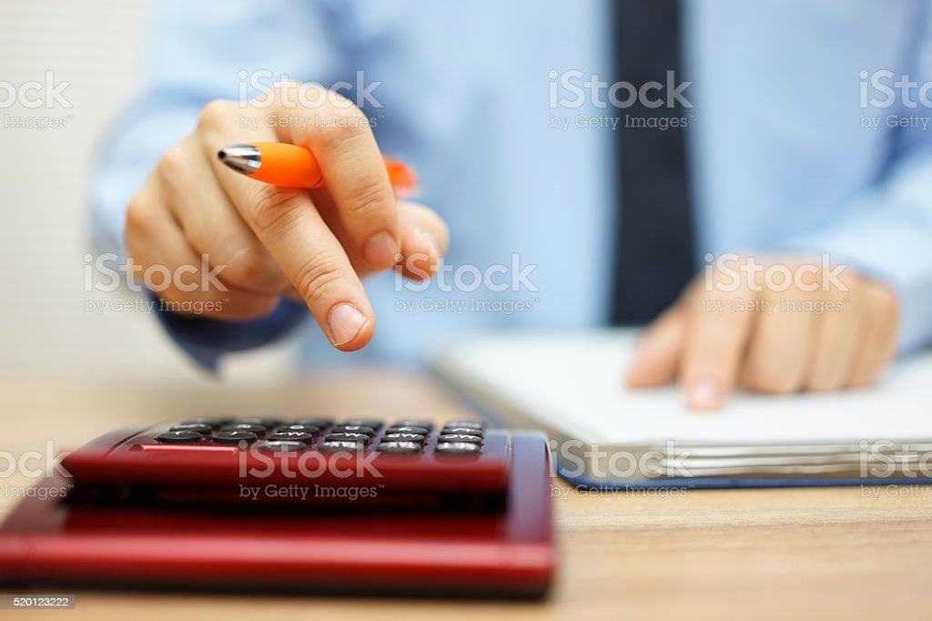 shallow depth of field of accountant calculating financial data stock photo