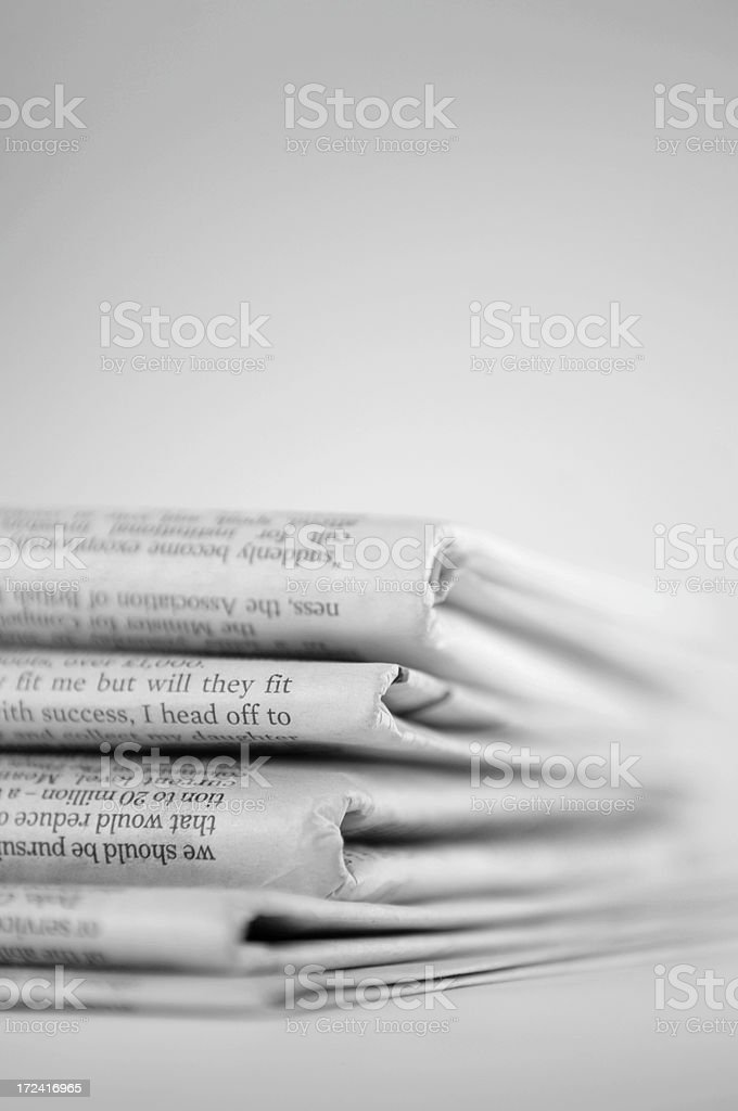 Shallow depth of field shot of newspaper stack royalty-free stock photo