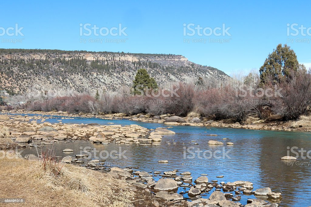 Shallow portion of the Animas river in Durango, Colorado stock photo