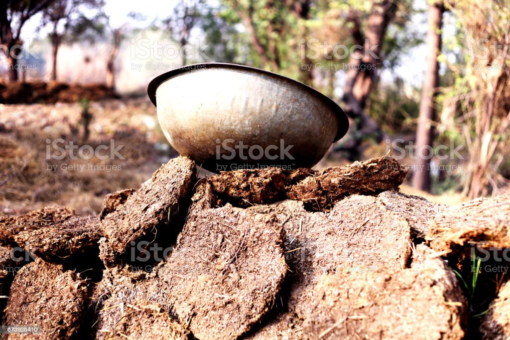 Shallowpan on dung cakes stock photo