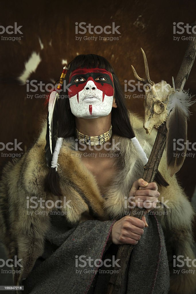 Shaman woman with war mask stock photo