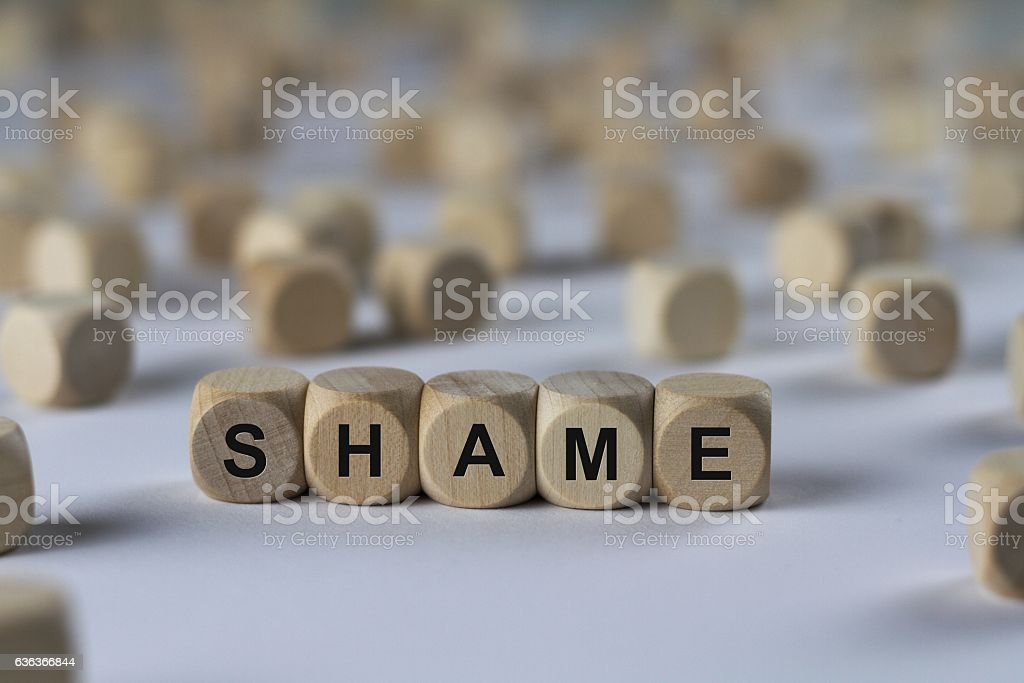 shame - cube with letters, sign with wooden cubes stock photo