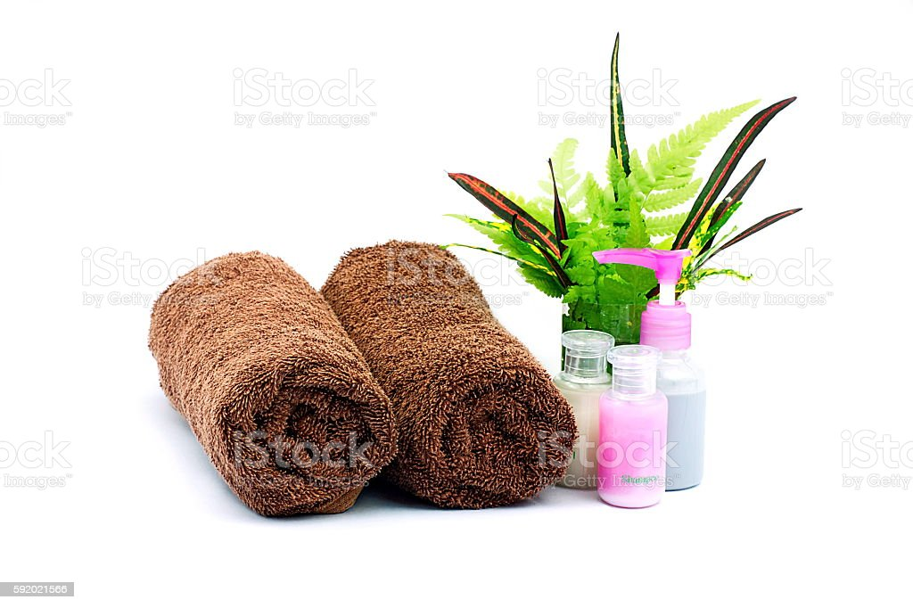 Shampoo and Shower gel bottles and brown towel stock photo