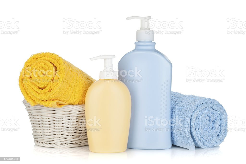 Shampoo bottles and towels royalty-free stock photo
