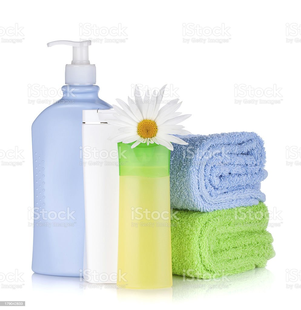 Shampoo bottles with towels and flower royalty-free stock photo
