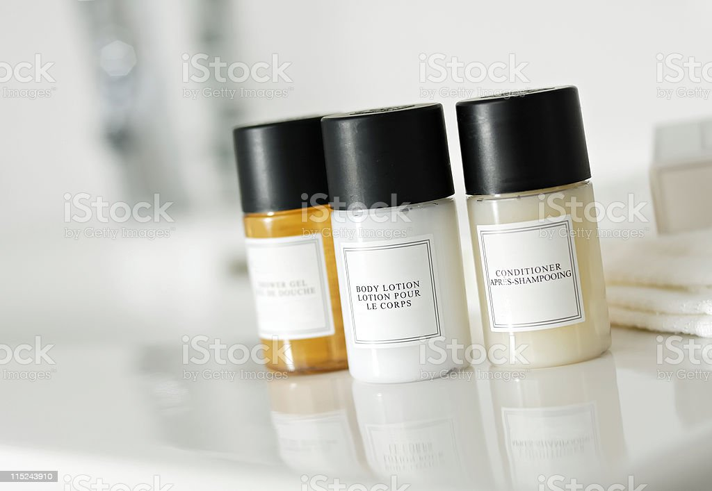 Shampoo, conditioner and soap bottles stock photo