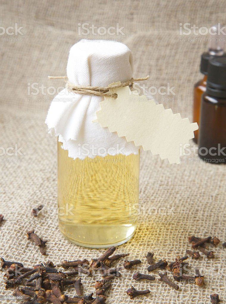 Shampoo with clove essential oil stock photo