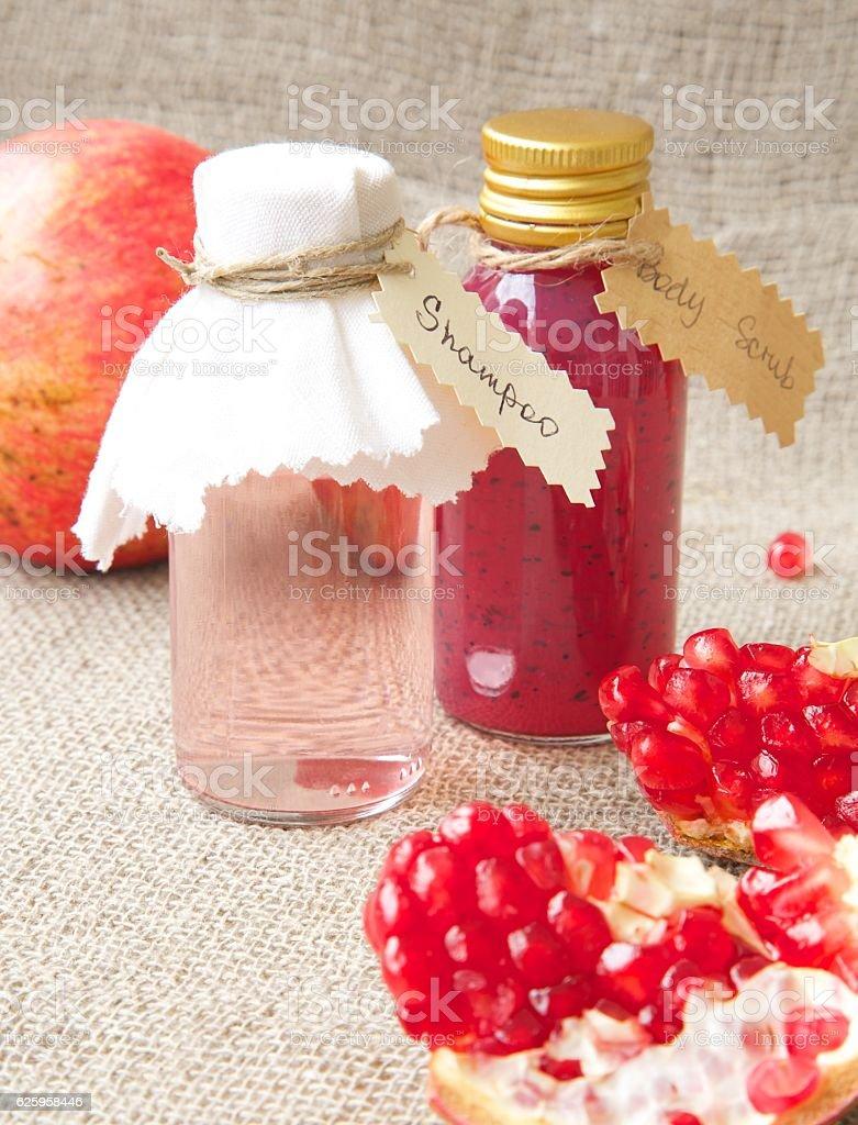 Shampoo with pomegranate oil stock photo