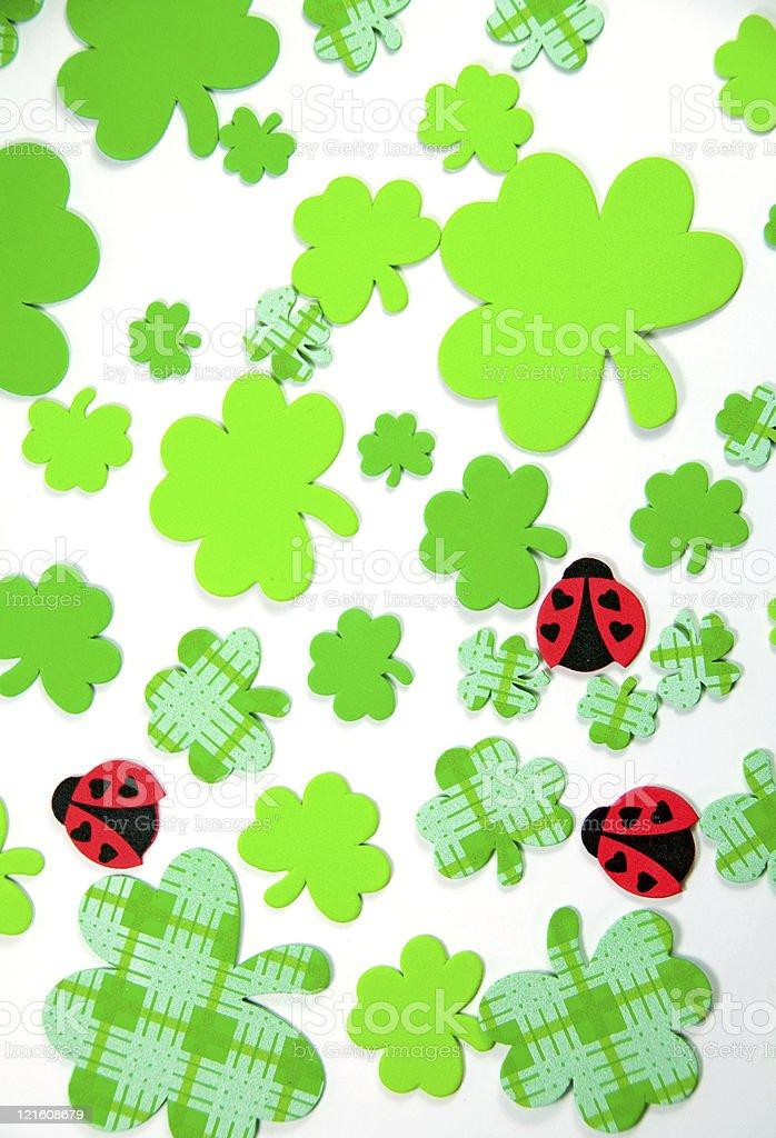 Shamrock and Ladybug Background stock photo