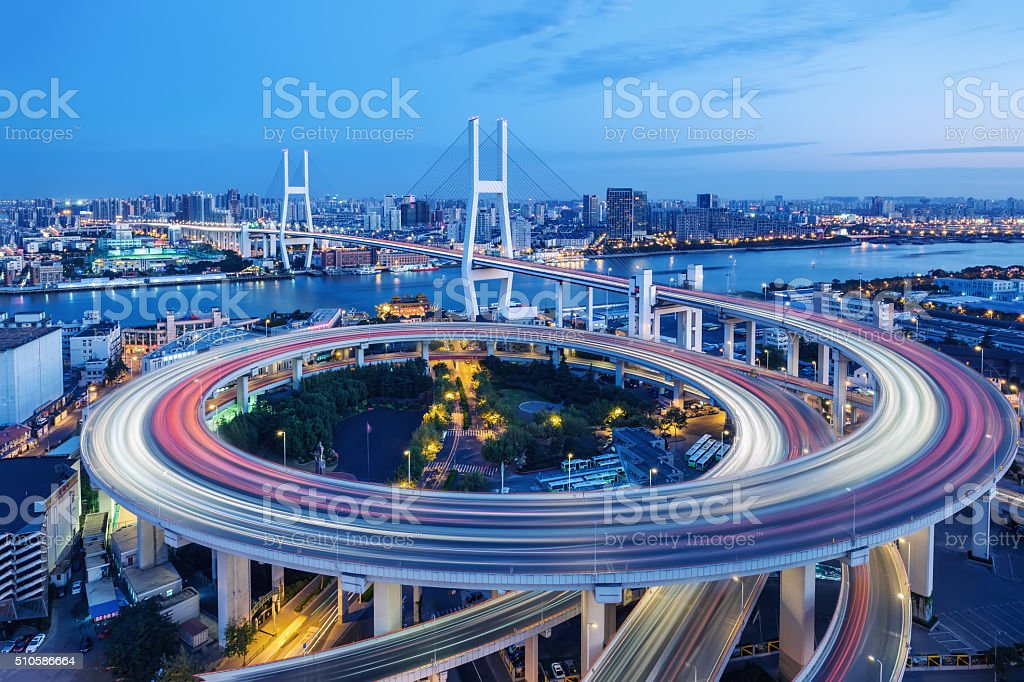 shanghai bridge at nighttime stock photo