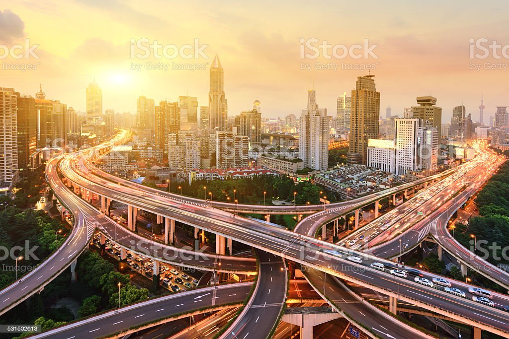 shanghai elevated road junction and interchange overpass at night stock photo