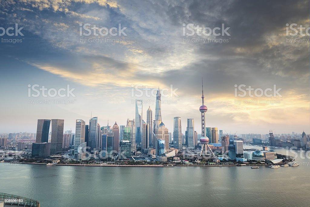 shanghai financial district skyline at dusk stock photo