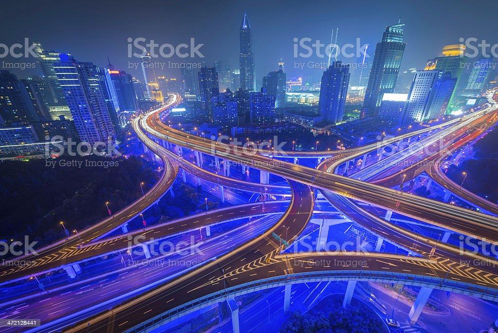 Shanghai futuristic cityscape illuminated neon skyscrapers and highway China royalty-free stock photo