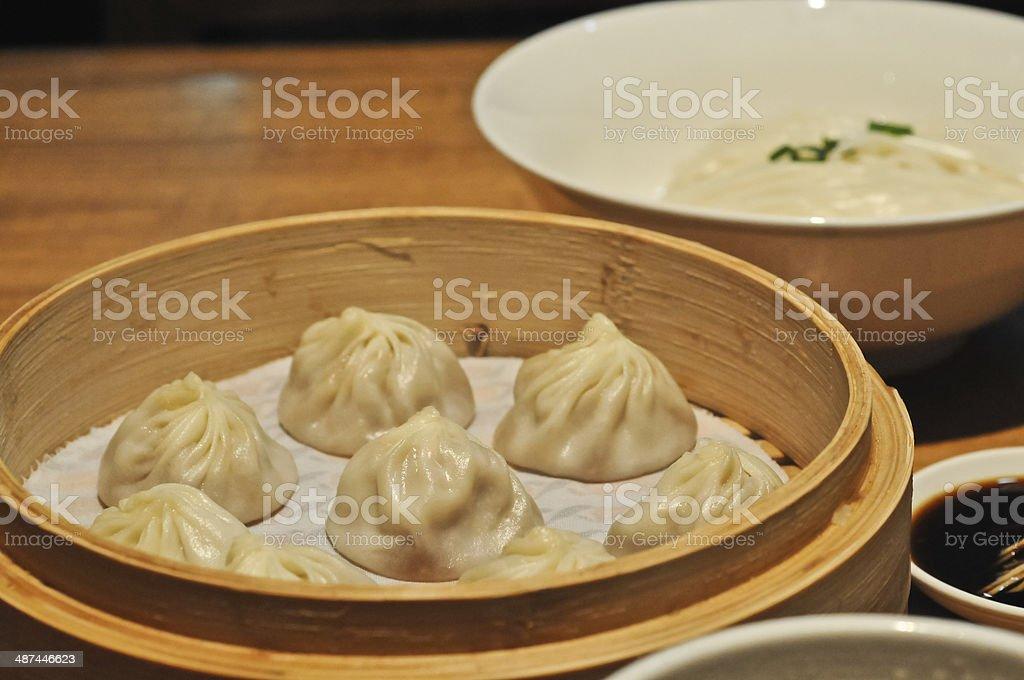 Shanghai mini bun Xiao Long Bao with plain noodle stock photo