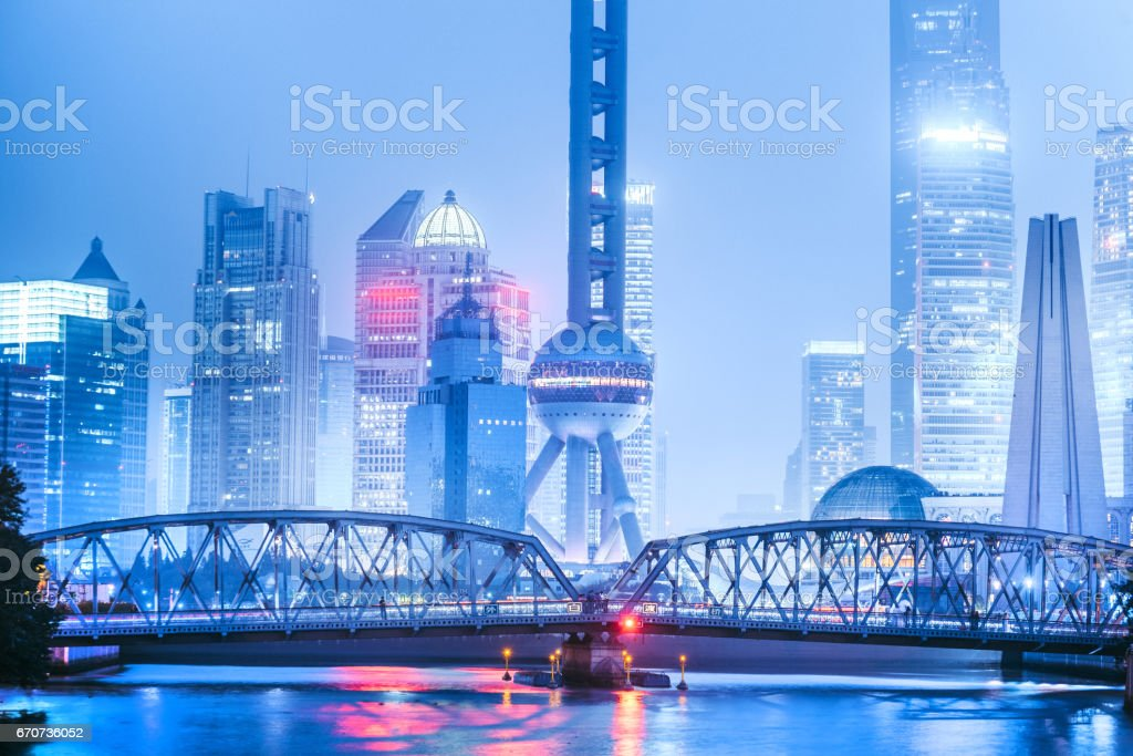 Shanghai modern illuminated Skyline at dusk stock photo