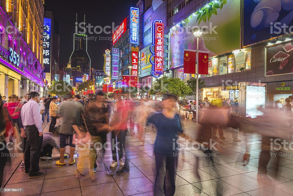 Shanghai Nanjing Road consumer crowds shopping under neon signs China stock photo