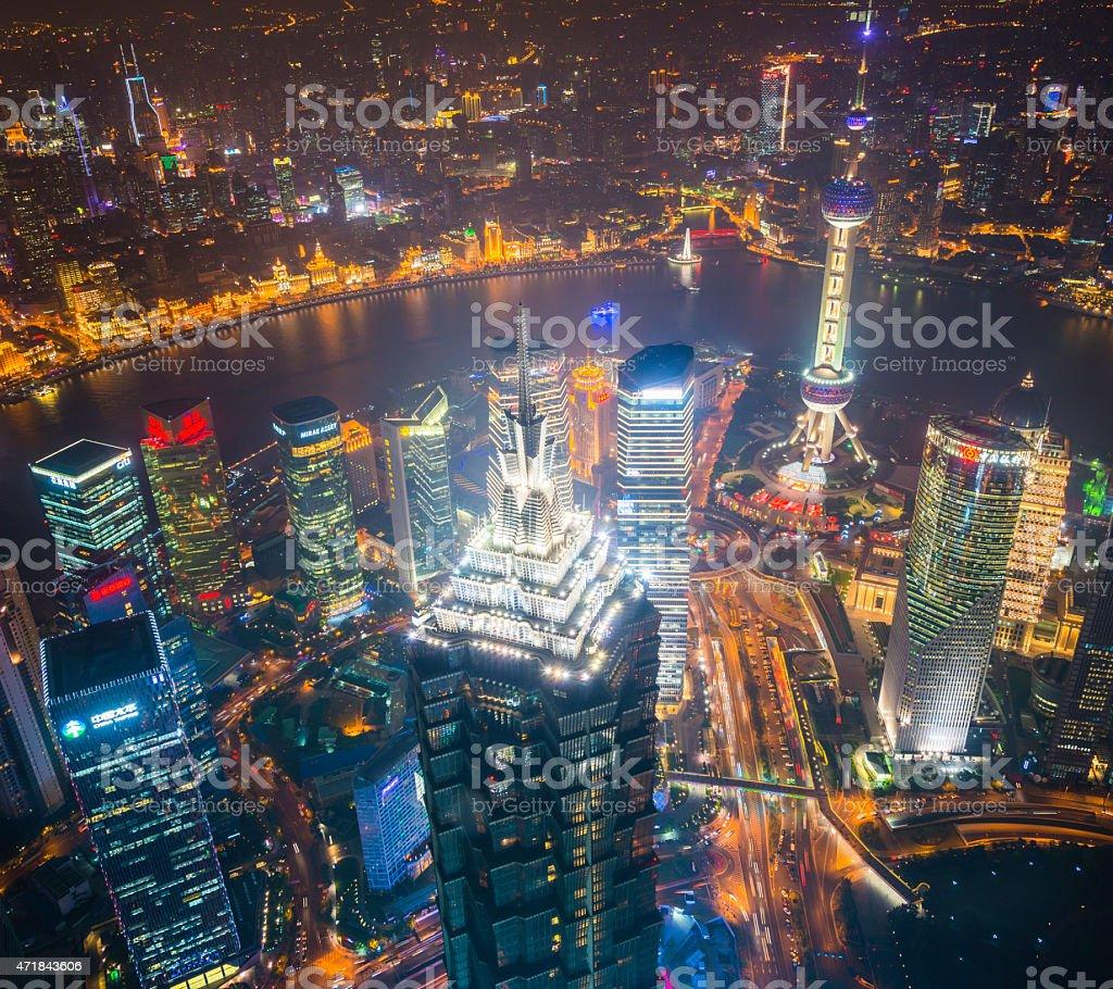 Shanghai neon night skyscrapers of Pudong overlooking The Bund China stock photo