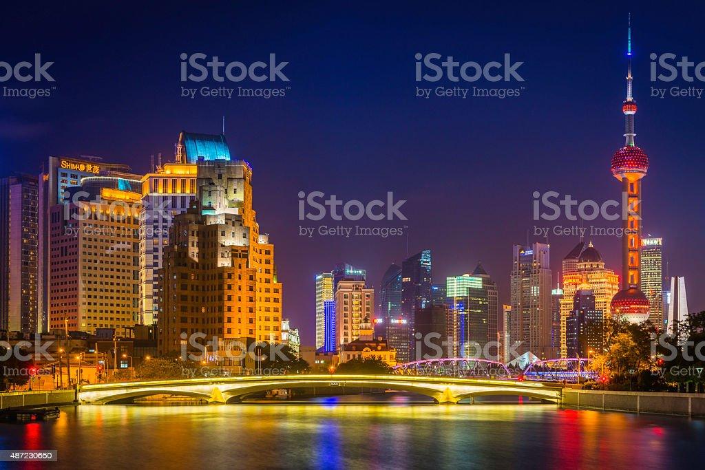 Shanghai Oriental Pearl Tower neon spotlit skyscrapers at night China stock photo