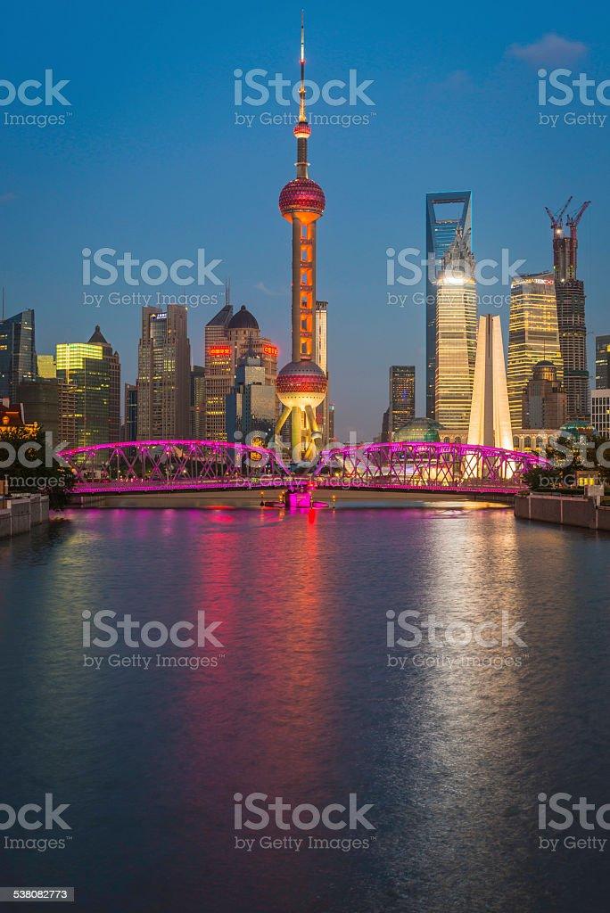 Shanghai Oriental Pearl Tower Waibaidu bridge skyscrapers illuminated dusk China stock photo