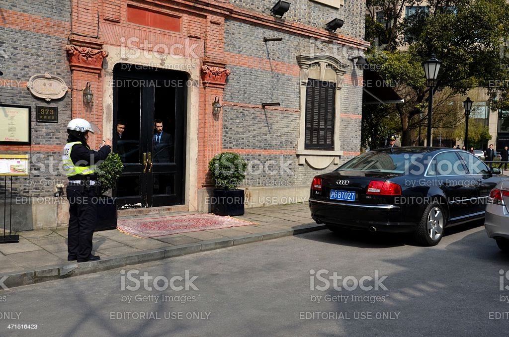 Shanghai policeman issues parking ticket, China stock photo