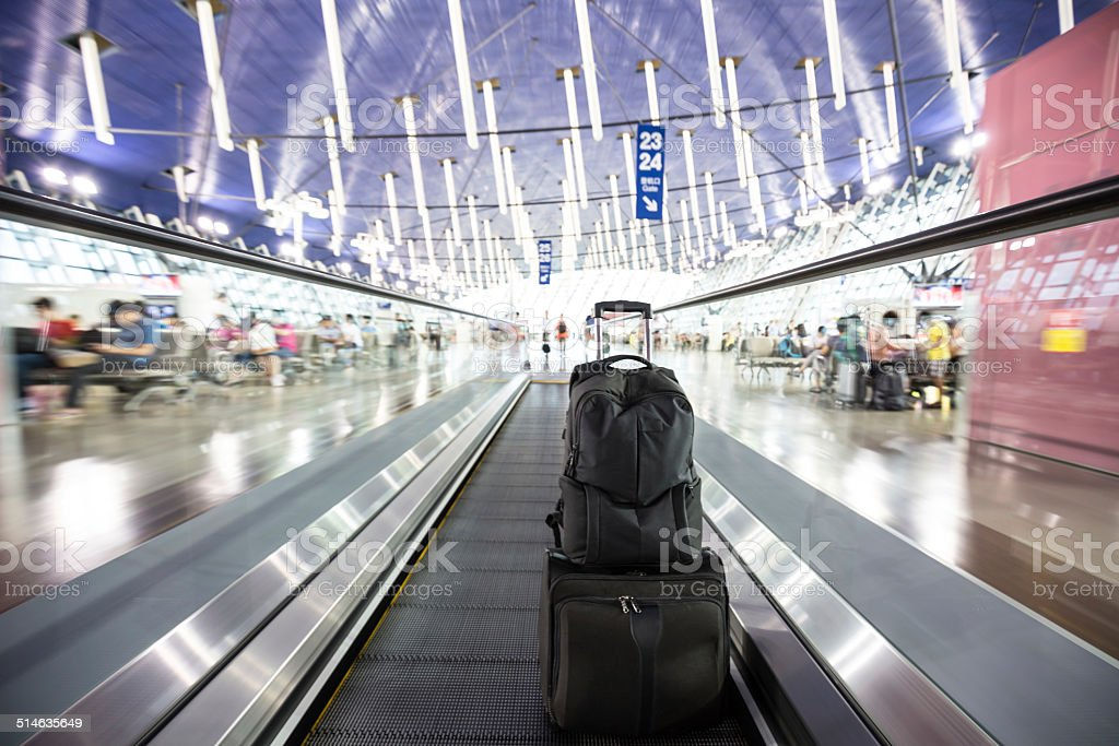 Shanghai PVG with suitcase and bag stock photo